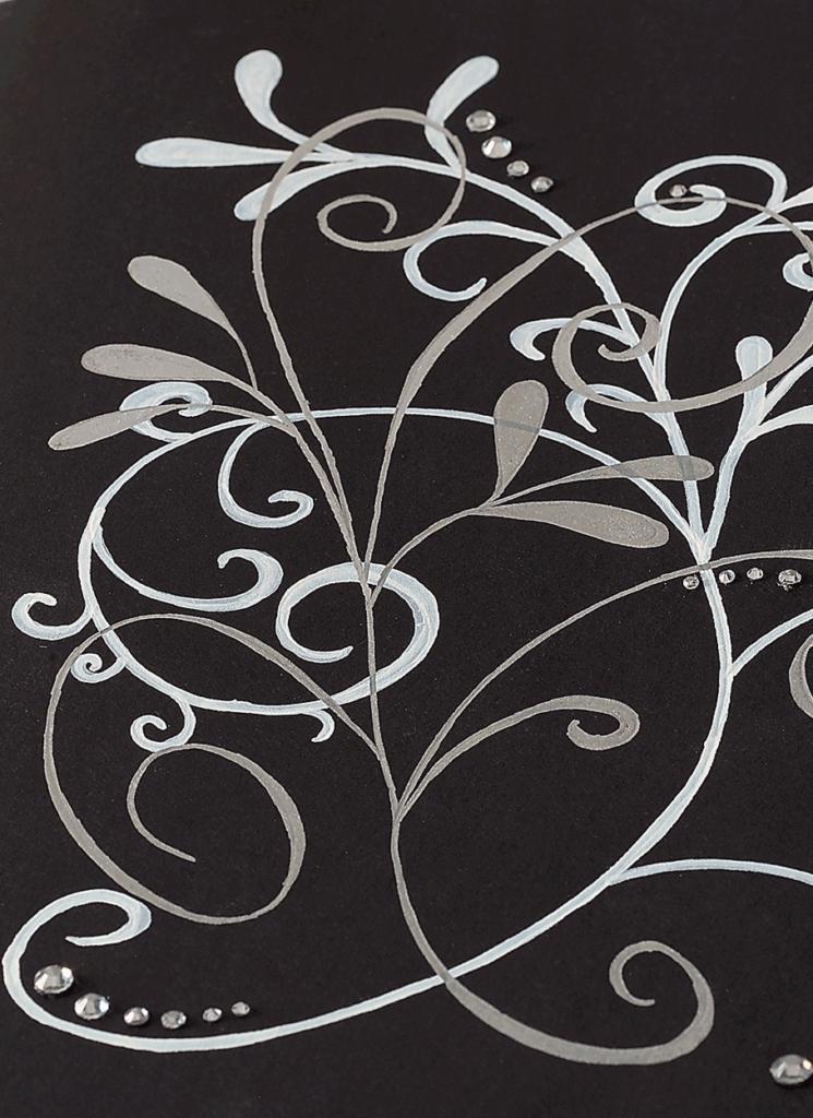 Eine Detailansicht vom Buch für Notizen mit einem weißem Mistelzweig.