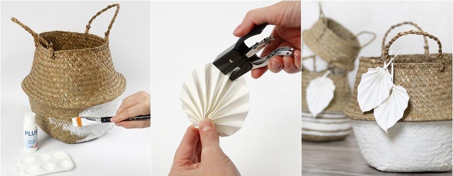 Ein Seegraskorb wird mit weißer Farbe bemalt und ein Blatt wird gefaltet.