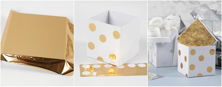 Eine Schachtel wird für ein Office mit Goldfolie beklebt.